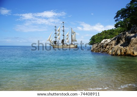 Beach and sail ship at Puerto Vallarta - stock photo