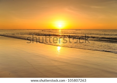 Beach and sea sunset - stock photo