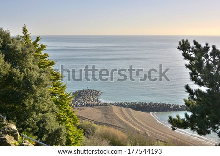 Beach and seafront viewed from The Leas clifftop at Folkestone in Kent. England - stock photo