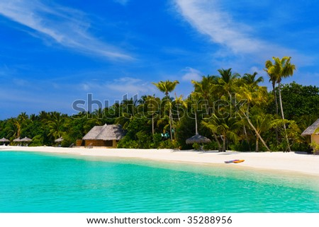 Beach at a tropical island - travel background - stock photo
