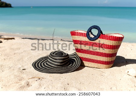 beach bag and hat on the tropical beach - stock photo