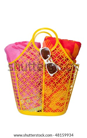 Beach bag, towels, sunglasses with sun reflection isolated on white background with clipping path. - stock photo