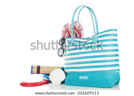 Beach bag with accessories with white background - stock photo