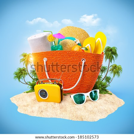 Beach bag with hat, towel and other on a sand. Travel Background - stock photo