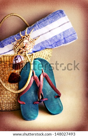Beach bag with towel,flip flops, shells,sunglasses /Vintage Summer holiday background - stock photo