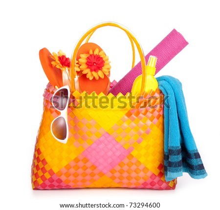 beach bag with towel sunglasses and flip-flops .isolated on white - stock photo