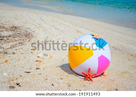 beach ball by a turquoise shore in Sardinia - stock photo