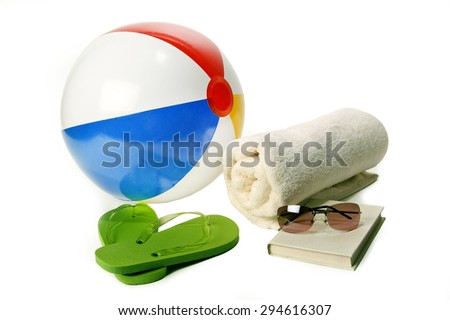 Beach ball, flip flops, towel and sunglasses/ Vacation Time Fun - stock photo