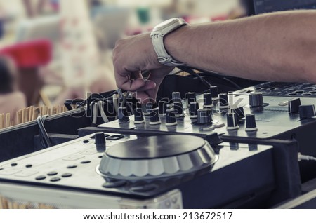 beach bar,typical summer scene of beach party and dj mixette and equipment in focus VINTAGE - stock photo