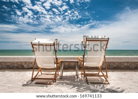 Beach bench - stock photo