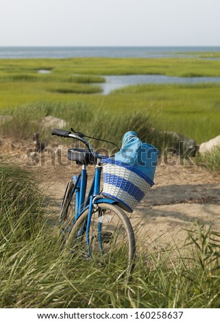 Beach bike with basket:  A great way to get to the beach on a nice day.  Taken in Cape Cod Mass. - stock photo