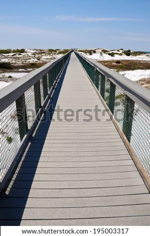 Beach Boardwalk across Sand Dunes to the Beach - stock photo