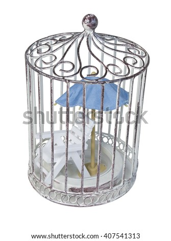 Beach Chair and Blue Umbrella in Birdcage - path included - stock photo