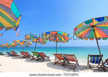 Beach chair and colorful umbrella on the beach , Phuket Thailand - stock photo