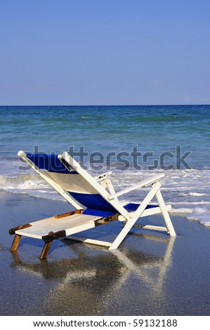 Beach Chair by the sea shore, perfect for cover art - stock photo