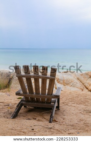Beach chair on the beach with a sea view - stock photo
