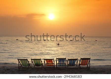 beach chair on the beach with sunset - stock photo