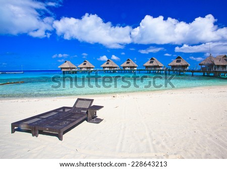 Beach chair on white sand sand beach, Bora Bora, French Polynesia, South Pacific  Concept for relaxation, vacation, resort - stock photo