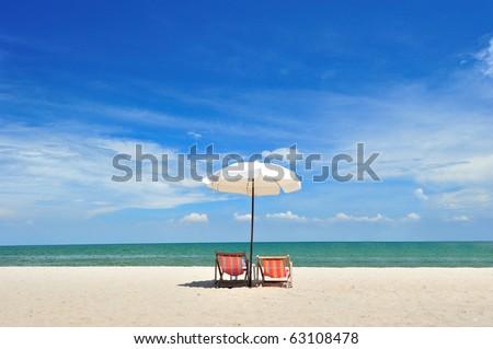 Beach chair with umbrella - stock photo