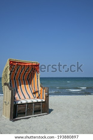 beach chair woth blue ksy - stock photo