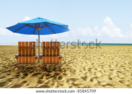 Beach chairs on perfect tropical golden sand beach - stock photo