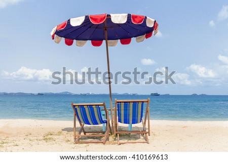 Beach chairs on the sand beach - stock photo