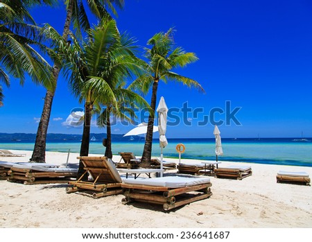 Beach chairs on tropical white sand beach - stock photo