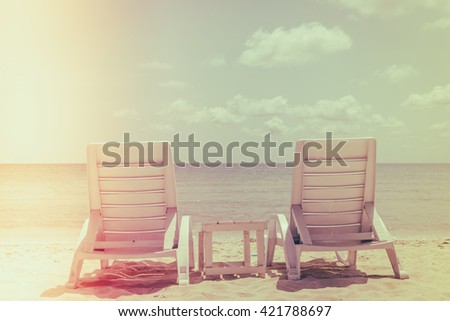 Beach chairs on tropical white sand beach ( Filtered image processed vintage effect. ) - stock photo
