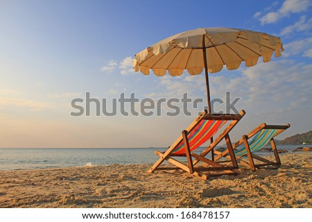 Beach chairs with umbrella at morning, samed island,thailand - stock photo