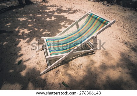 Beach colorful chair on the beach in Koh Samet Thailand vintage - stock photo