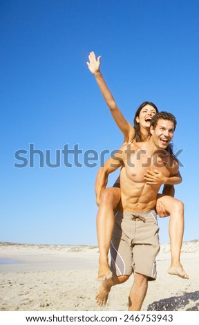 Beach couple running - stock photo