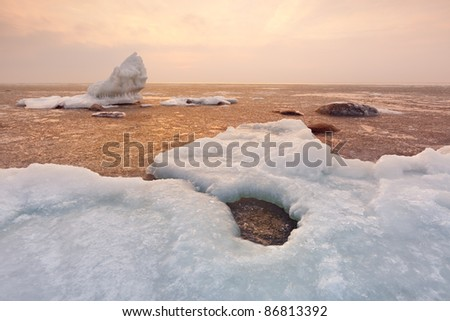 Beach covered with ice - stock photo