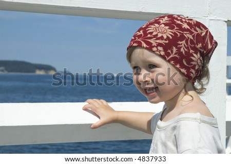 beach day. little girl looking at the water - stock photo