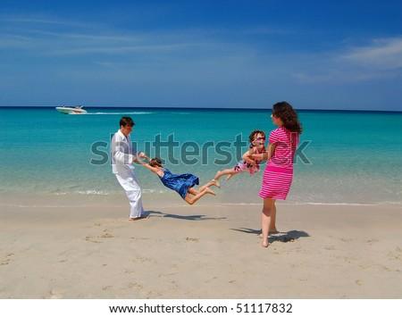 Beach family fun! - stock photo
