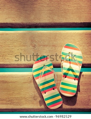 Beach flip flops on wood. Summer vacations background - stock photo