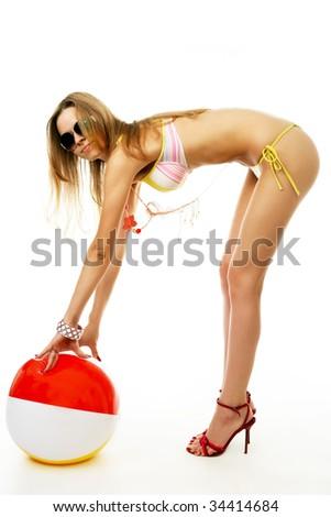 beach girl in bikini isolated on white with a beach ball - stock photo