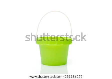 Beach green bucket against a white background - stock photo