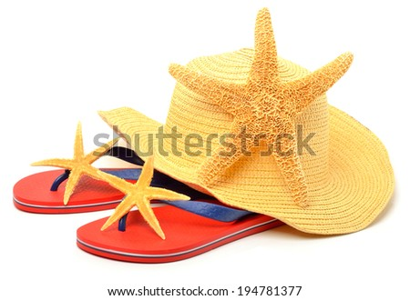 Beach hat, red flip flops with starfishes isolated on white - stock photo