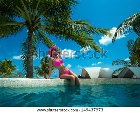 Beach holiday by the pool - stock photo