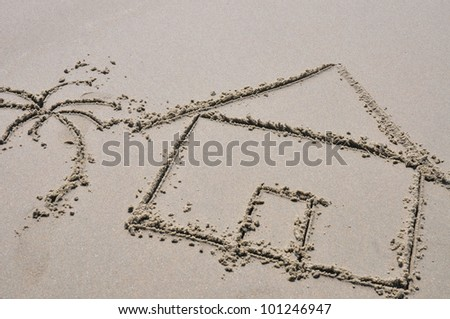 Beach house concept drawn in the sand - stock photo
