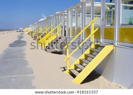 Beach houses along the North Sea on a sunny day, Netherlands - stock photo