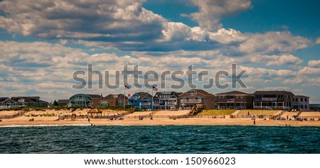 Beach houses and people on the beach in Point Pleasant, New Jersey. - stock photo