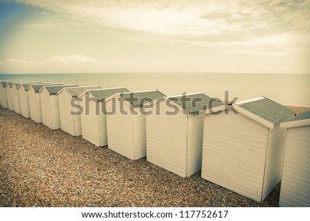 beach huts in seaside town bexhill on sea, east sussex England. small wood chalets on the coast - stock photo
