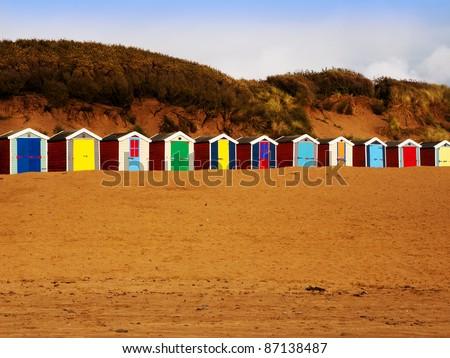 beach huts saunton sands devon - stock photo