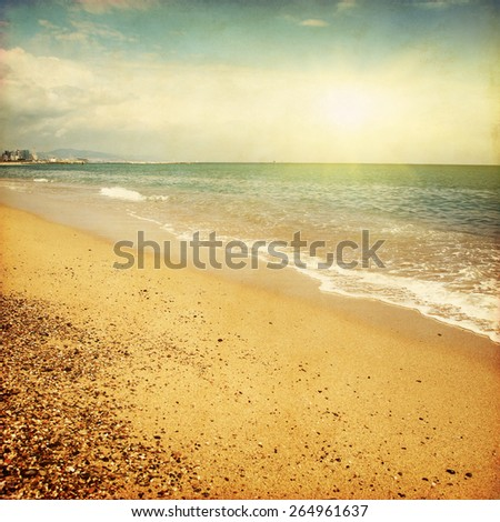 Beach in Barcelona at sunset in grunge style. - stock photo