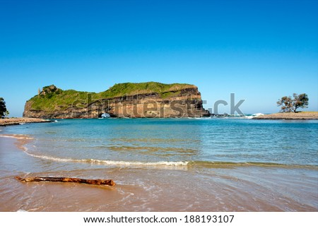 Beach in front of Hole in the Wall tourist attraction. Shot in Coffee Bay, Eastern Cape, South Africa. - stock photo