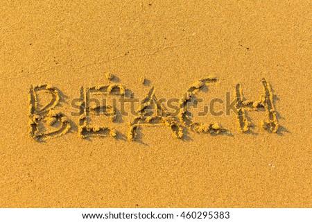 Beach - inscription on sea sand. - stock photo