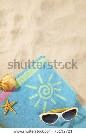beach items on a towel with copy-space.