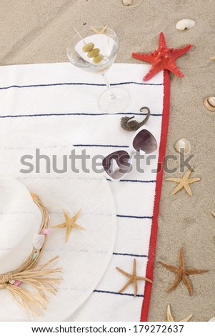 beach items on sand for fun summer holiday - stock photo