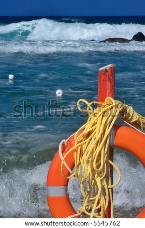 Beach life saver with rough sea and big waves in the background - stock photo